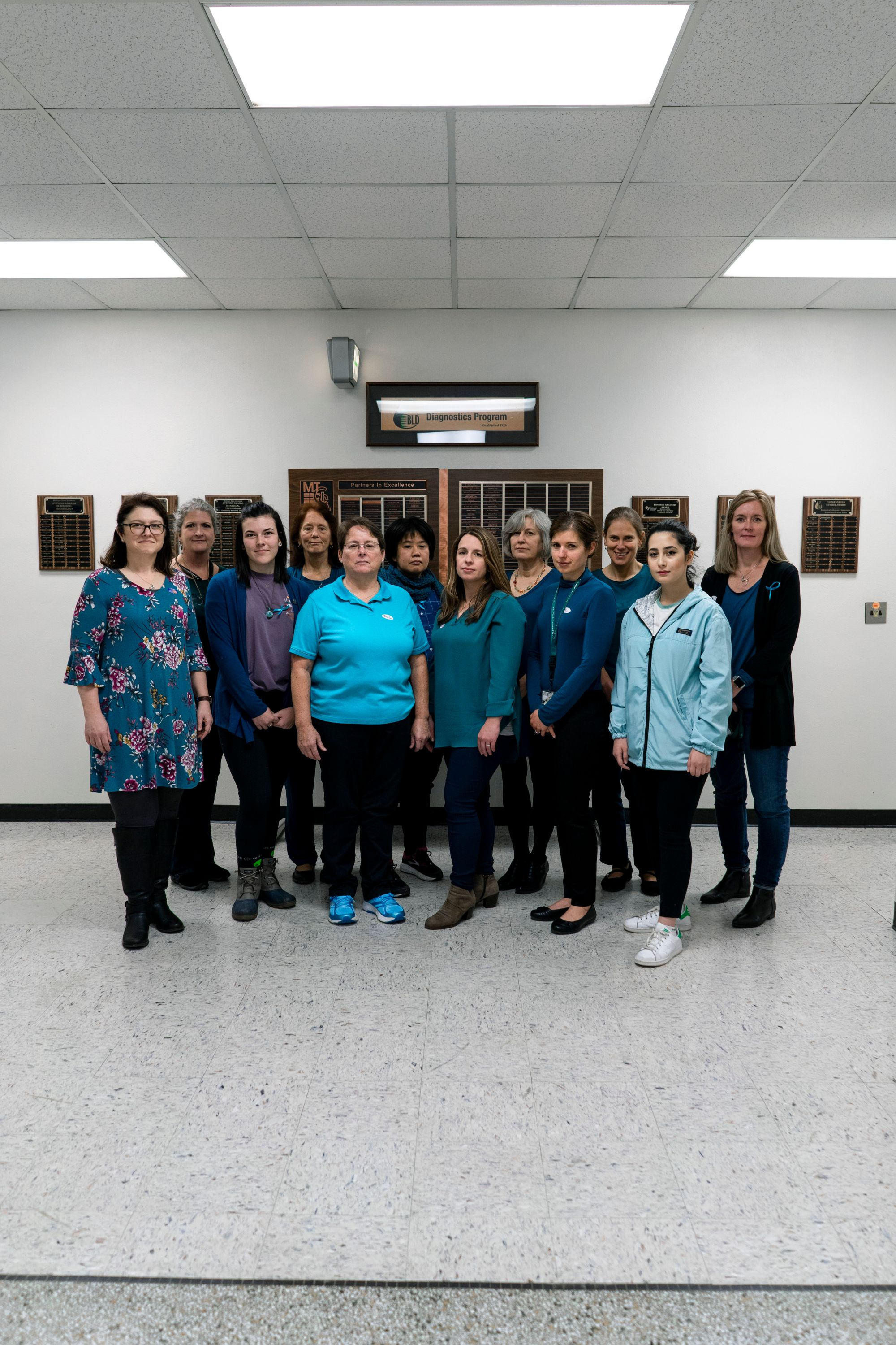 A photo of BLD Faculty Staff and Students wearing teal